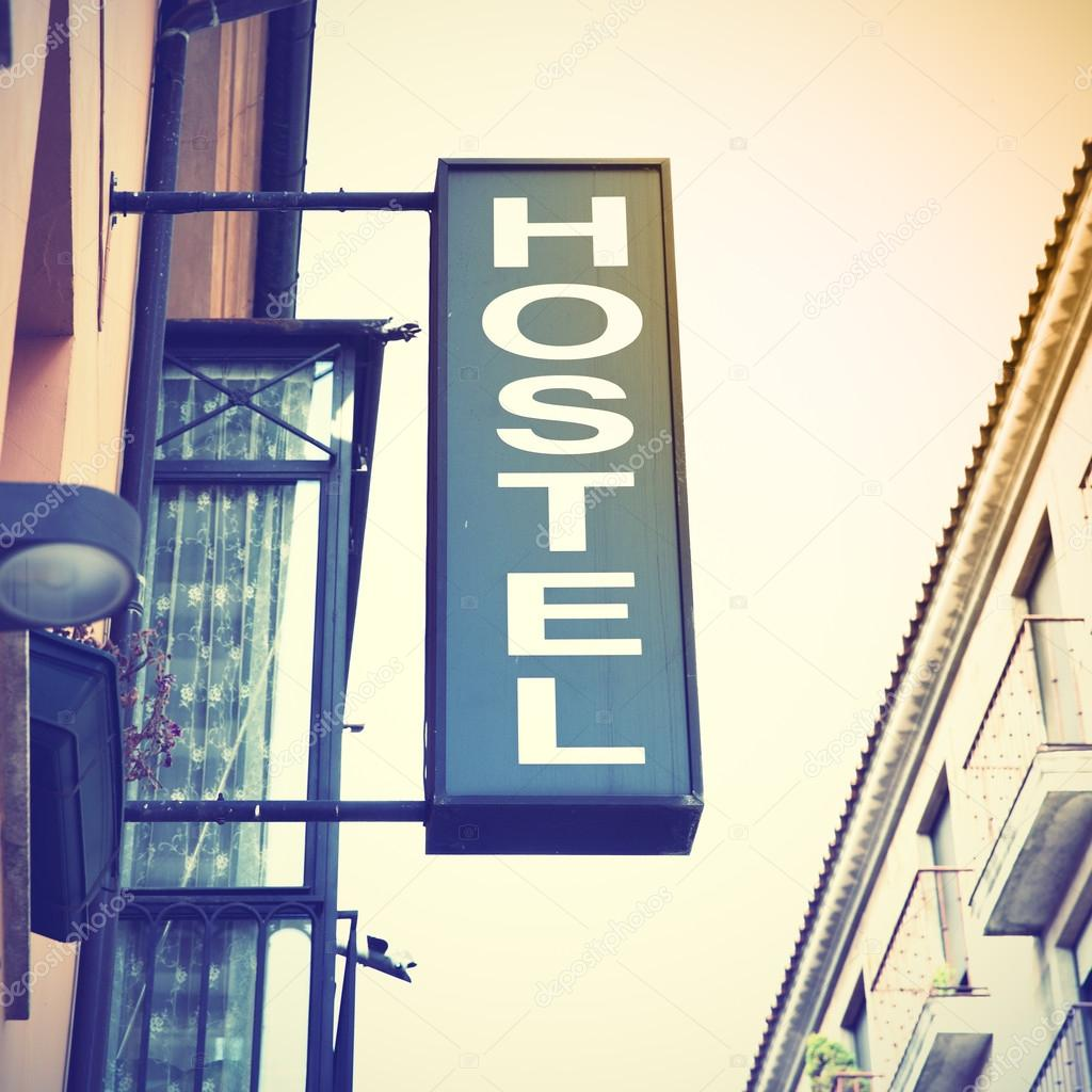 depositphotos_123820362-stock-photo-signboard-od-hostel